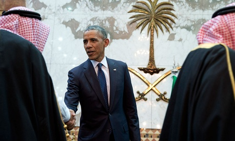 President Barack Obama participates in a receiving line with the Saudi Arabian King, Salman bin Abdul Aziz, at Erga Palace in Riyadh, Saudi Arabia in 2015.