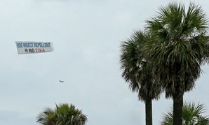 An aerial banner is flown over the South Pointe Park area in early September.