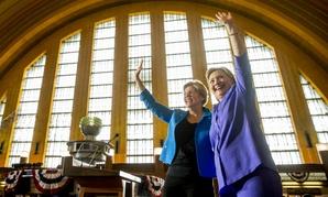 Sen. Elizabeth Warren, D-Mass., (left) campaigns with Democratic presidential nominee Hillary Clinton in Ohio in June.