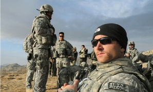 Staff Sgt. Shawn Kruse waits for a helicopter in Jaghori, Afghanistan, in 2009.