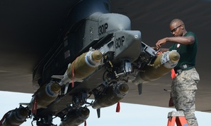 Staff Sgt. Stefano Cothran, a 2nd Aircraft Maintenance Squadron weapons load team member, secures a GBU-38 Joint Direct Attack Munition to a pylon during the 2014 Global Strike Challenge on Barksdale Air Force Base, La. in 2014.