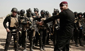 A soldier from the 1st Battalion of the Iraqi Special Operations Forces takes part in during a training exercise to prepare for the operation to re-take Mosul from Islamic State militants in August.