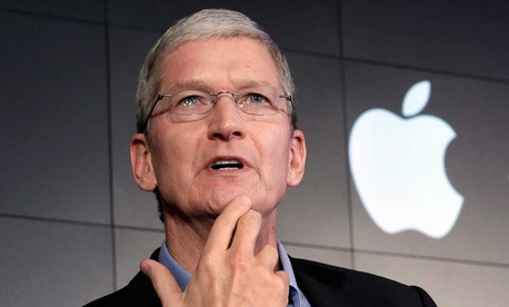 Tim Cook responds to a question during a news conference in New York in 2015.