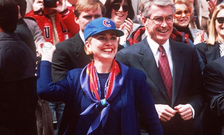 Accompanied by then-Illinois Gov. Jim Edgar, Clinton throws out the first pitch at a Cubs game in 1994.