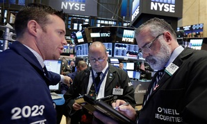 Specialist Frank Masiello, left, works with traders Jeffrey Vazques, center, and Kenneth Polcari on the floor of the New York Stock Exchange in October.