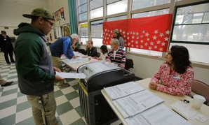 A man turns in his ballot in Ventura County during the California primary June 7.