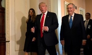 President-Elect Donald Trump walks with his wife, Melania, and Senate Majority Leader Mitch McConnell  during his visit to Capitol Hill last week.