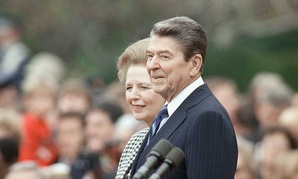 Margaret Thatcher and Ronald Reagan walk in Washington in 1988.