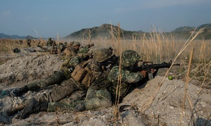 """U.S. and Philippine Marines fire their rifles """"shoulder-to-shoulder"""" during Balikatan 16, at Crow Valley, Philippines in April."""