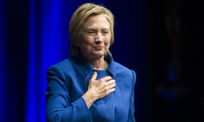 Hillary Clinton places her hand over her heart as she walks to the podium to address members of the Children's Defense Fund in Washington on Nov. 16.