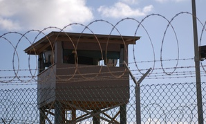 A soldier stands guard in a tower at Camp Delta at Joint Task Force Guantanamo Bay in 2009.
