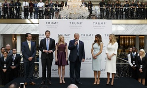 Then candidate Donald Trump, with his wife and grown children, speaks during the Oct. 26 grand opening of the Trump International Hotel in the Old Post Office in Washington.