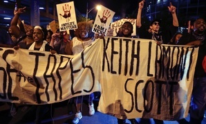 Protesters shout as they march in the streets of Charlotte, N.C., to protest the fatal police shooting of Keith Lamont Scott in September.