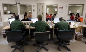 U.S. Customs and Border Protection agents work at a processing facility in 2012 in Texas.