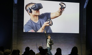 Oculus Founder Palmer Luckey talks about the Rift virtual-reality headset during a news conference Thursday, June 11, 2015, in San Francisco.