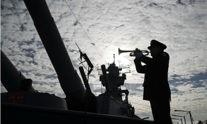 Greg Murphy plays the Navy Hymn during a ceremony commemorating the 75th anniversary of the Japanese attack on Pearl Harbor, on board The Battleship New Jersey Museum and Memorial in Camden, Dec. 7.