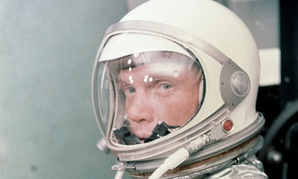 John H. Glenn Jr. dons his silver Mercury pressure suit in preparation for launch in 1962.