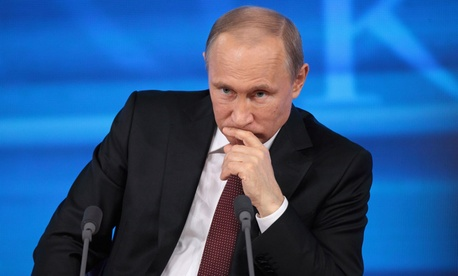 Vladimir Putin listens to a question in 2015 during a press conference.