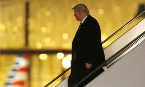 President-elect Donald Trump walks down the stairs from his plane after returning from Wisconsin to LaGuardia Airport Dec. 13.