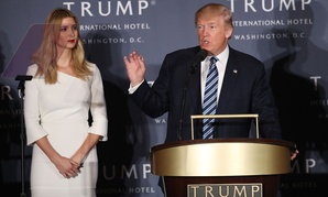 Donald Trump, accompanied by his daughter, Ivanka Trump, speaks during the grand opening of Trump International Hotel in Washington in October.