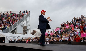 Donald Trump arrives to speak at a rally at Ladd-Peebles Stadium on Saturday in Mobile, Ala.