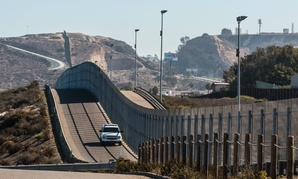A Border Patrol vehicle patrols the international border between San Diego and Tijuana, Mexico.