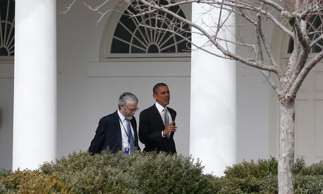 Barack Obama walks with John P. Holdren, Assistant to the President for Science and Technology and Director of the White House Office of Science and Technology Policy in 2014.