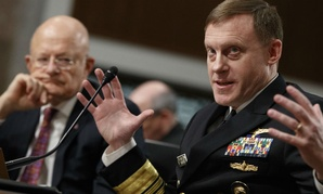 Director of National Intelligence James Clapper listens at left as National Security Agency and Cyber Command chief Adm. Michael Rogers testifies on Capitol Hill in Washington, Thursday, Jan. 5, 2017.