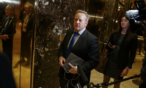 Trump spokesman Sean Spicer talks with reporters in the lobby of Trump Tower in New York.