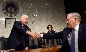 Senate Armed Services Committee Chairman Sen. John McCain, R-Ariz., left, shakes hands with Defense Undersecretary Frank Kendall, the military's chief weapons buyer, right, before the start of a hearing on Capitol Hill in 2016.