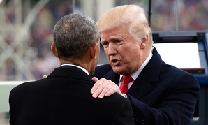 President Donald Trump talks with former President Barack Obama on Capitol Hill after Trump took the presidential oath