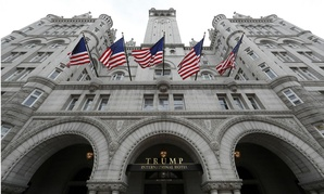 Trump's stake in the Trump International Hotel in Washington creates a conflict of interest for the new president, government ethics officials have said.