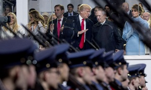 President Donald Trump talks with Defense Secretary James Mattis in the reviewing stand for Trump's inaugural parade.