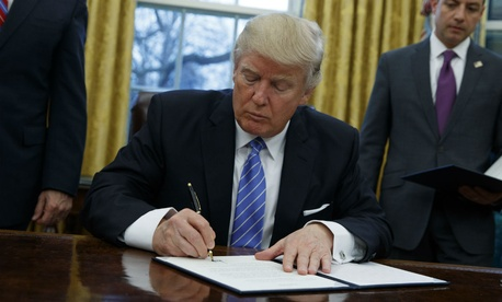 President Trump signs an executive order on Monday.