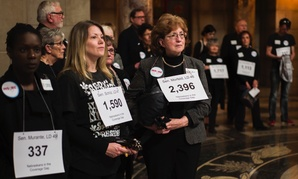 Supporters of a bill that would have used federal Medicaid and state dollars to provide insurance coverage to low-income residents stand outside the Legislative Chamber in Lincoln, Nebraska on March 29.