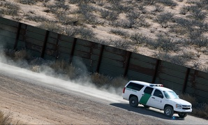 A Border Patrol truck secures border fence line in Arizona in 2011.