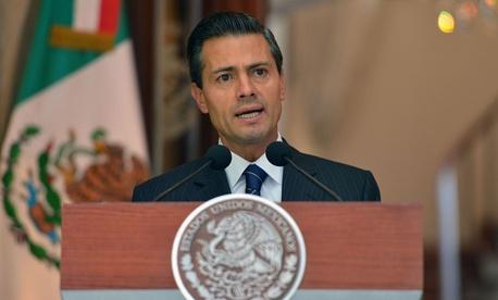 Enrique Peña Nieto is shown in 2014 in Mexico City.