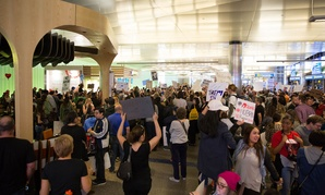 Protesters demonstrate at Los Angeles International Airport Sunday.