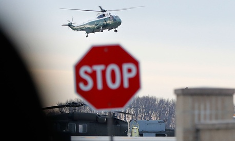 Marine One, with President Donald Trump aboard, lands at Dover Air Force Base, Del., Wednesday.