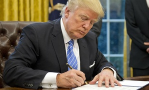 President Trump signs executive orders on Jan. 23.