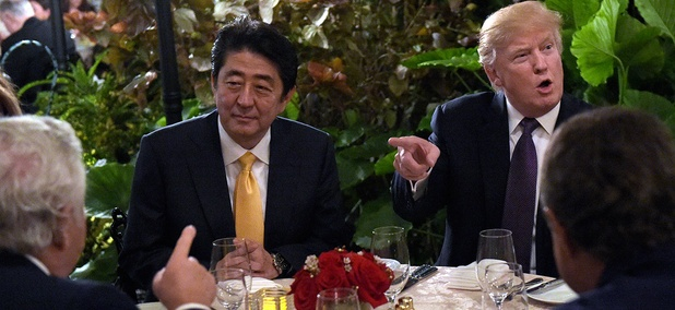 Donald Trump sits down to dinner with Japanese Prime Minister Shinzō Abe, second from left, at Mar-a-Lago in Florida on Friday, Feb. 10.