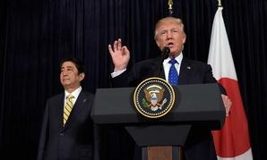 President Donald Trump speaks as Japanese Prime Minister Shinzo Abe listens on Saturday at Mar-a-Lago.