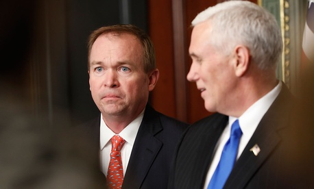 Vice President Mike Pence looks to Mick Mulvaney, Director of Office of Management and Budget in the White House complex in Washington, Thursday, Feb. 16, 2017, during a swearing in ceremony.