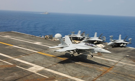 An F/A-18F Super Hornet, assigned to the Red Rippers of Strike Fighter Squadron (VFA) 11, lands on the flight deck of the aircraft carrier USS Theodore Roosevelt (CVN 71) in 2015.