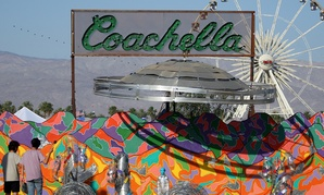 "Festival-goers view the ""Coachella Bound"" art installation at the campgrounds at The Coachella Music and Arts Festival in 2015."
