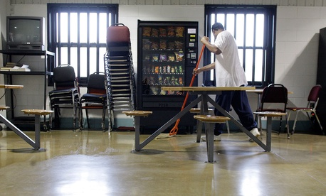 An inmate mops the floor in the merit dorm at North Central Correctional Institution in Marion, Ohio in 2011.