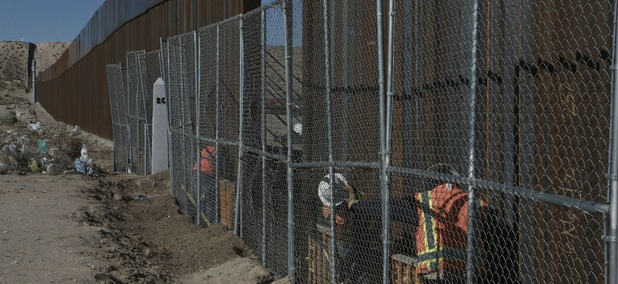 Workers raise a taller fence in the Mexico-US border separating the towns of Anapra, Mexico, and Sunland Park, New Mexico, in January.
