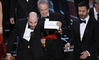 """Jordan Horowitz, producer of """"La La Land,"""" shows the envelope revealing """"Moonlight"""" as the true winner of best picture at the Oscars on Sunday, Feb. 26."""