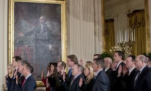 Senior White House officials are sworn in on Jan. 22.