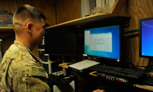 Senior Airman Andrew Dawson updates a computer system at Bagram Air Field, Afghanistan, in 2016.